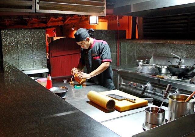 cook working in modern kitchen