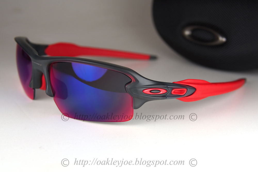 Black and red oakley flak jacket