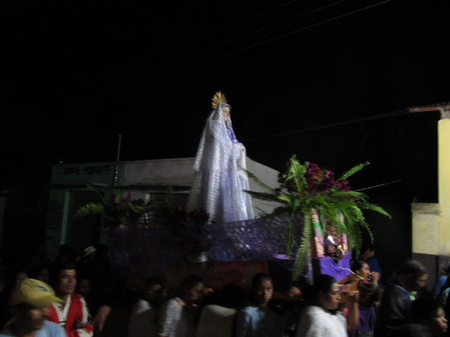 Women Carry Mary behind him