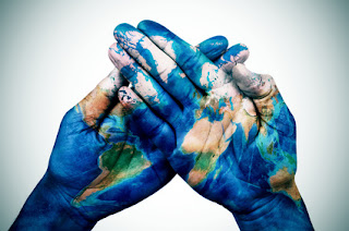 Pic of two hands with world map painted on them