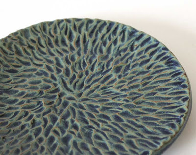 glazed carved pottery plate