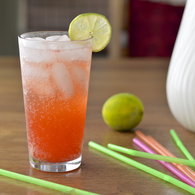 Homemade strawberry soda made with a fresh strawberry simple syrup, seltzer and a squeeze of lime.