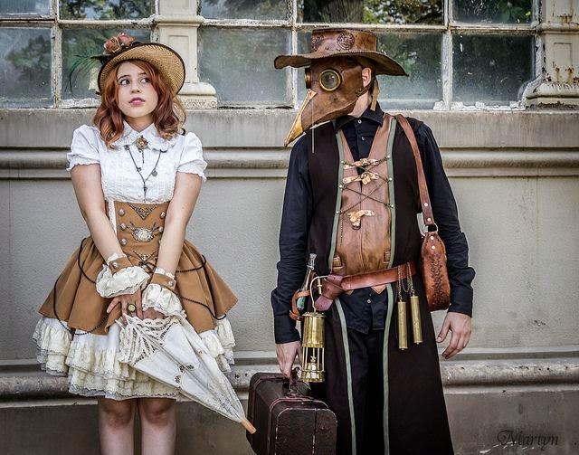 steampunk woman fashion clothing men man bird mask leather