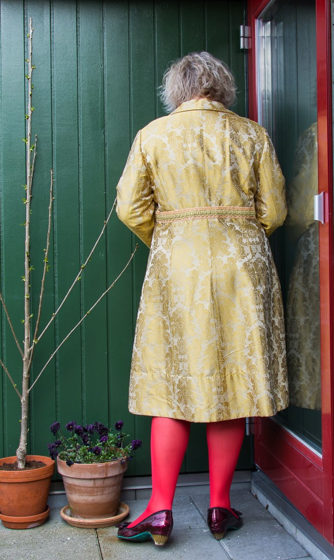 The backside of Tribute to Sacramento outfit in gold brocade coat