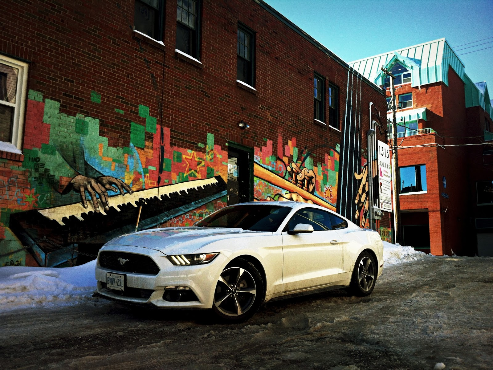 2015 Ford Mustang V6 front three quarter white