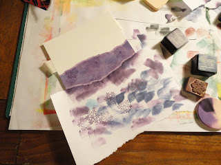 Purple sponged snowflake panel with torn paper mask