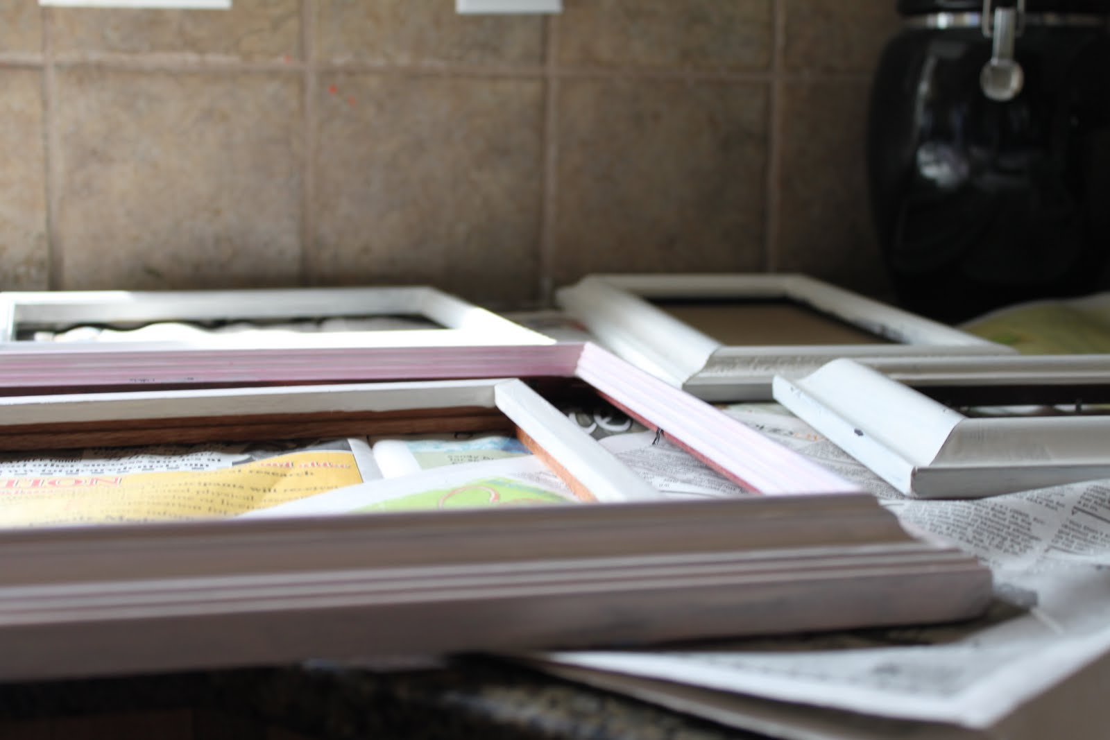 Do it yourself divas diy painting picture frames despite the fun we had crafting away we were a bit discouraged until steph had the ingenious idea of using spray paint primer and paint to fix our now very jeuxipadfo Choice Image