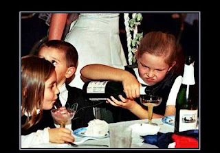 alcoholic children pouring wine at party