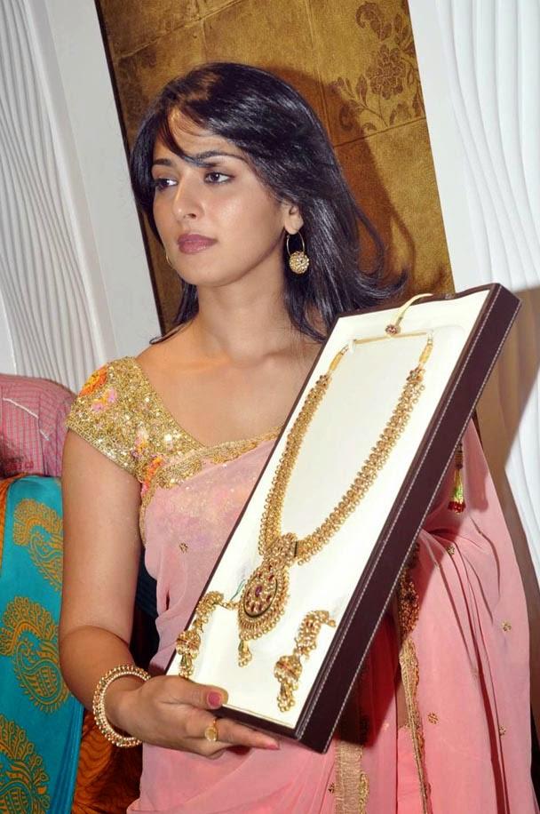 Actress Anushka Sheety in transparent saree