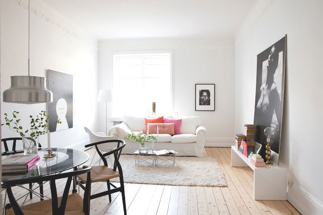 Living and dining room with black wishbone chairs