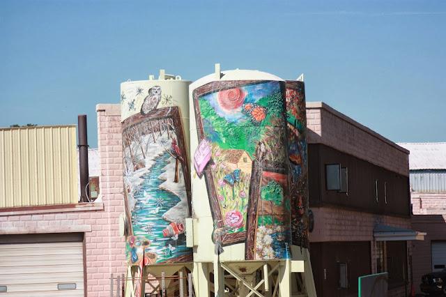 Murals on three storage towers