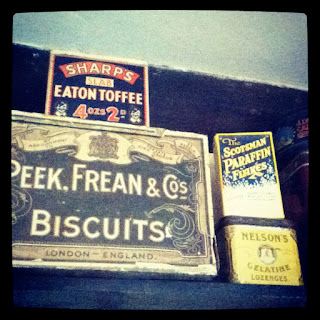 Old biscuit tins in the kitchen at Avebury Manor