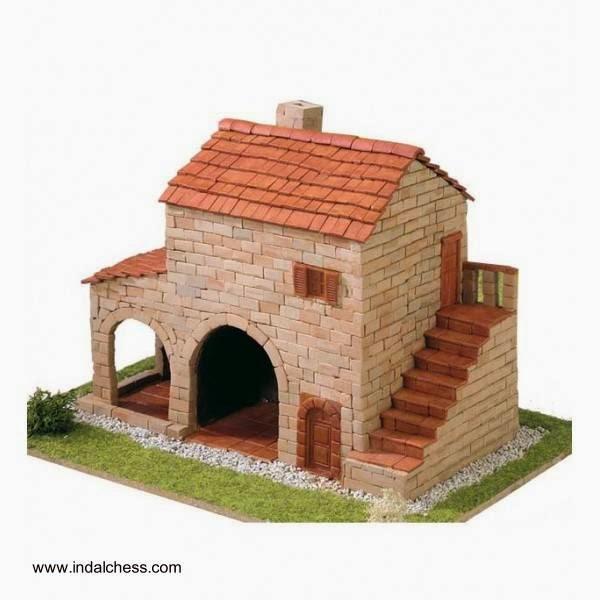 Maqueta de una casa de pueblo hecha con piedra y cerámica