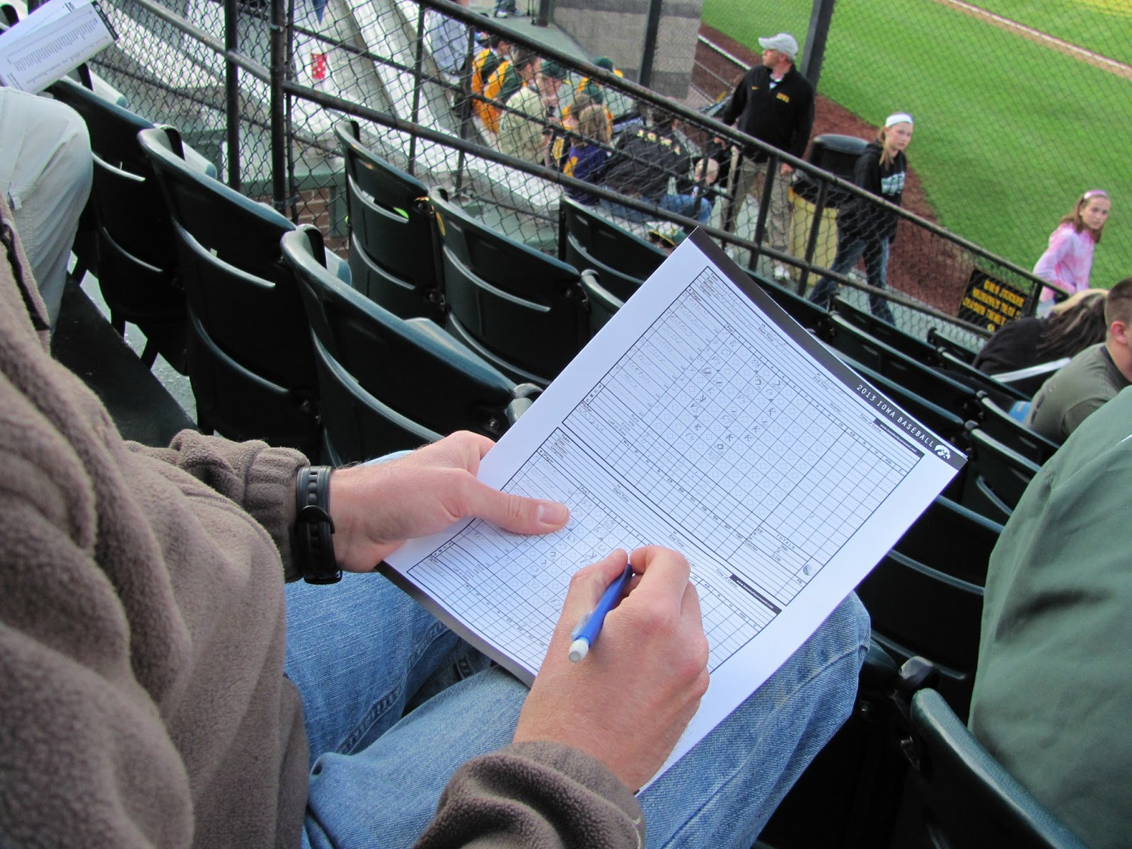 Cory keeps the scorecard at the Iowa baseball game