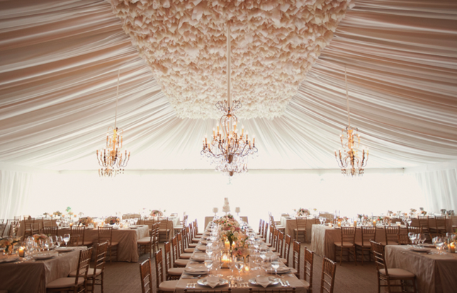 15 swoon worthy tent wedding ideas belle the magazine for Wedding tent lighting ideas