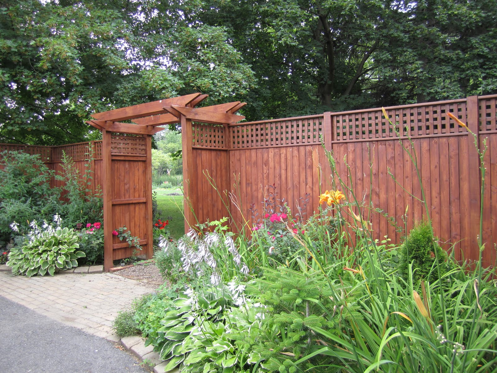 Birch aspen fence between house garage for Garage fence