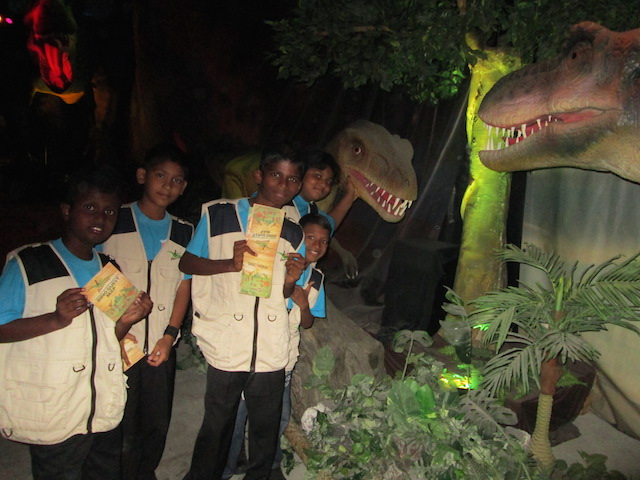 Children from Rumah Kebajikan Mary at the baby T-Rex exhibit