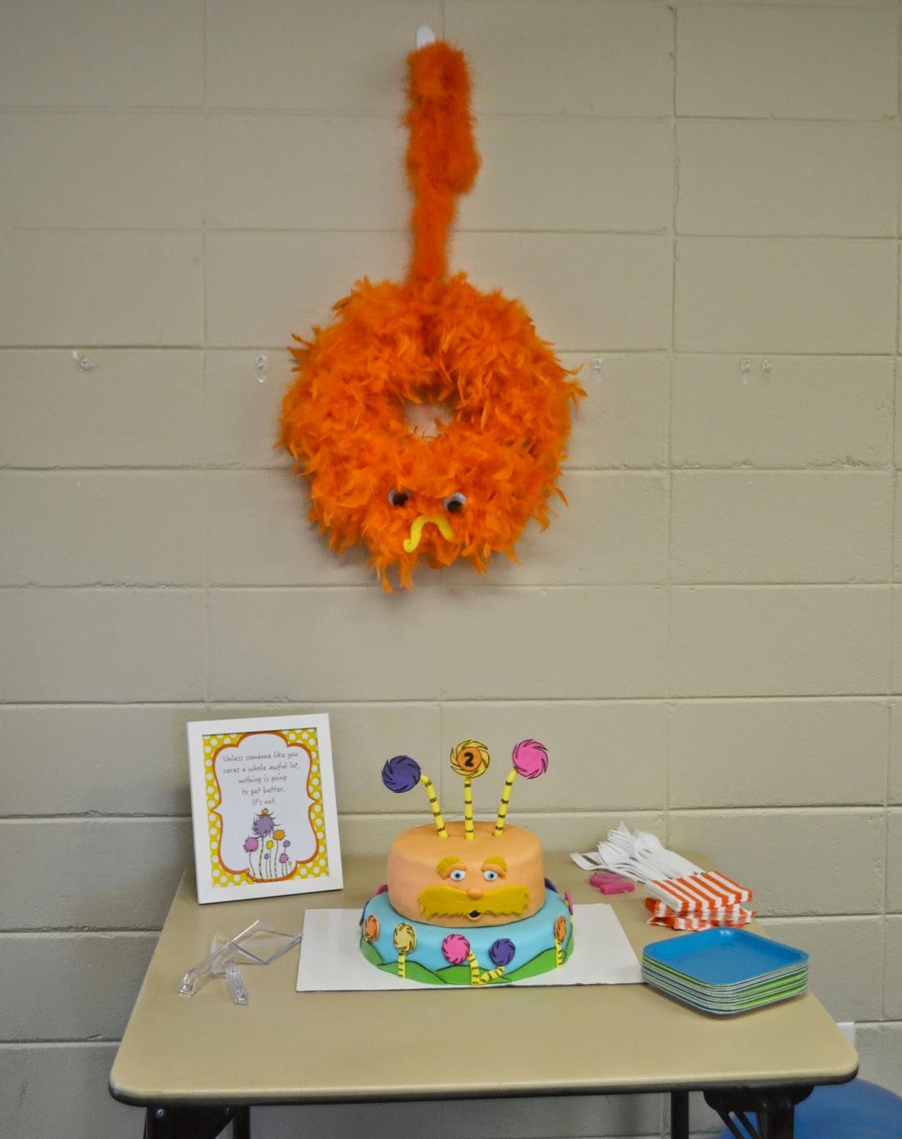 The Lorax Wreath #DIY. Lorax Wreath.  The Lorax Birthday Party.  Lorax Birthday party.  The Lorax Birthday Party ideas.  Lorax party decorations.  Lorax birthday decorations.