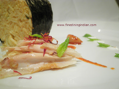 fine dining indian picture of sous vide chicken biriyani presentation