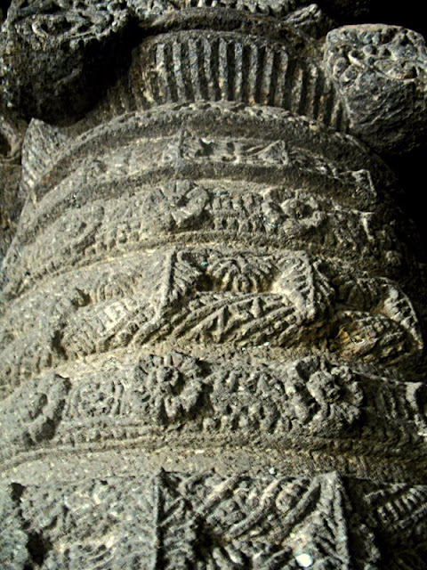 decorated stone pillar at Aurangabad temple caves