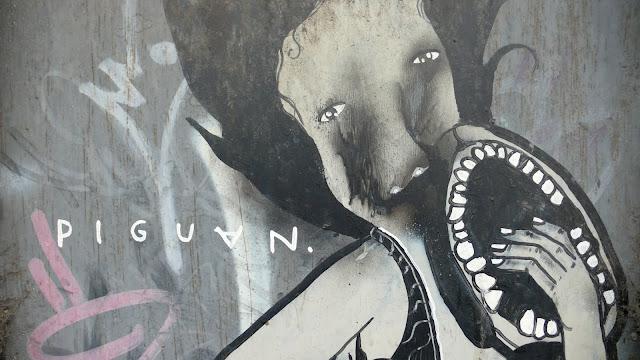 piguan graffiti street art in recoleta, santiago de chile