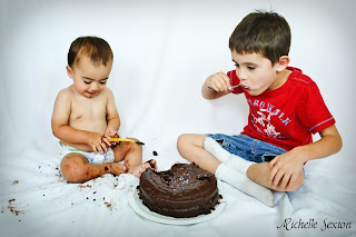 boys eating chocolate cake with spoons
