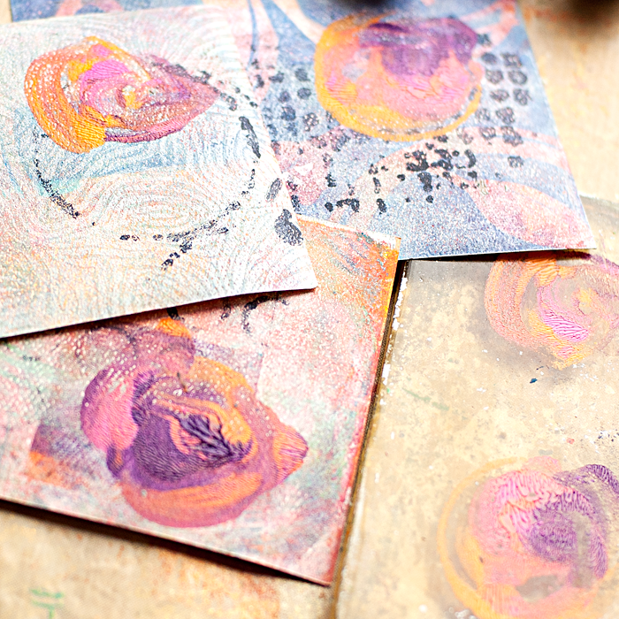 4 step mixed media tutorial using a Gelli Plate and Paint Brushes to paint your print making design onto scrapbook paper