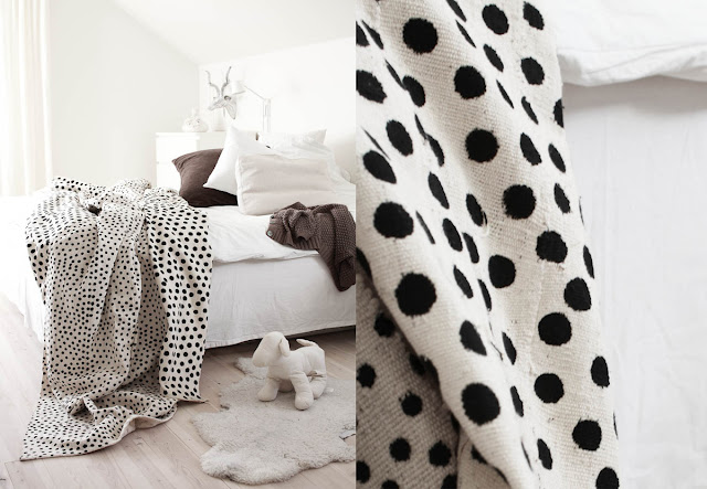 White bedroom with ikata polka dot duvet cover