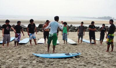 Surfers receiving instructions during a surf clinic. — Bernama