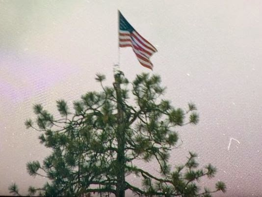 http://www.krem.com/story/news/local/kootenai-county/2015/04/23/mystery-person-puts-flag-on-top-of-coeur-dalene-tree/26269449/