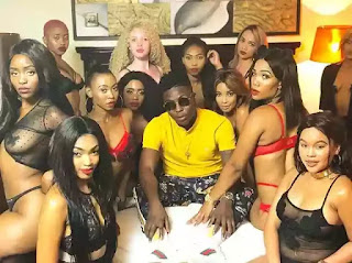 Reekado Banks with semi-nude girls
