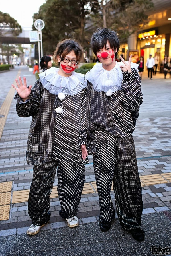Two boys dressed as monochrome clowns