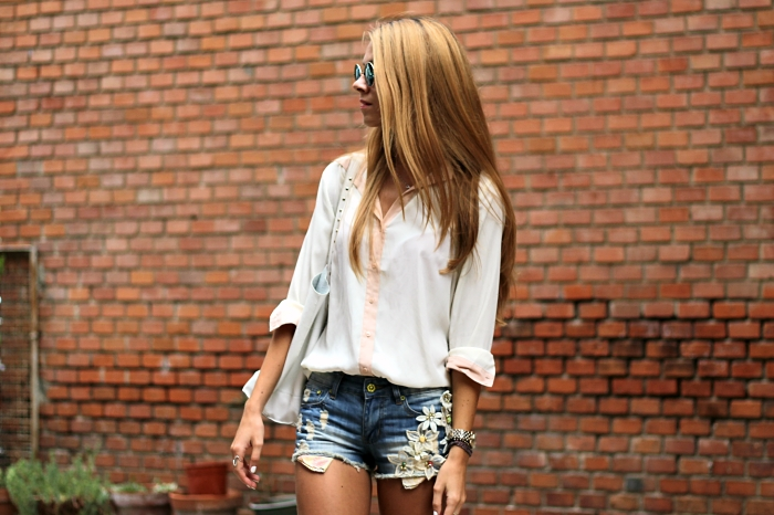 denim shorts, white shirt, mirror sunglasses