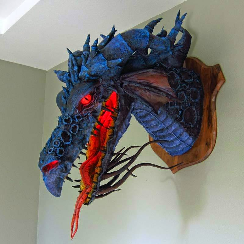 white wolf paper mache artist creates amazing dragons