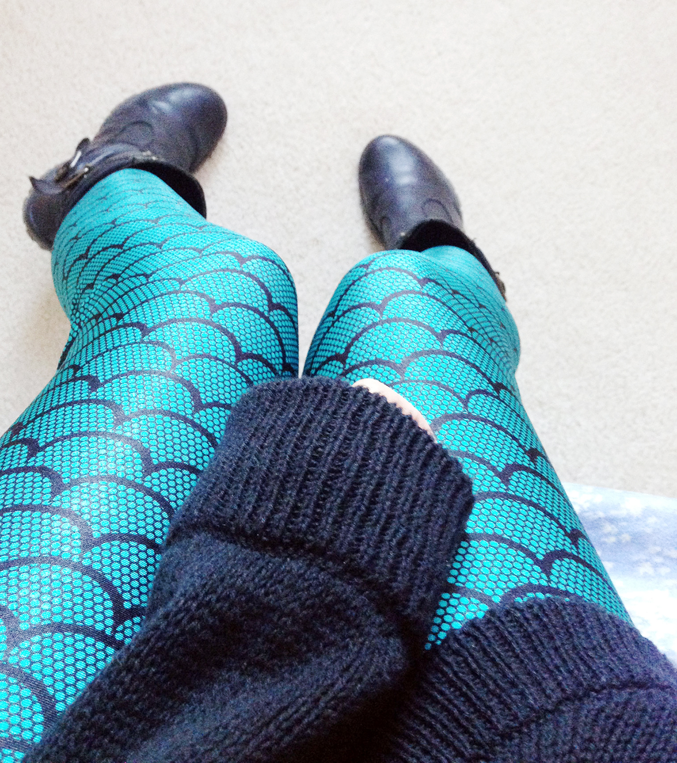 Close up of the shiny, smooth teal-colored material of these stylish and chic Mermaid leggings from Krazycloset Clothing!