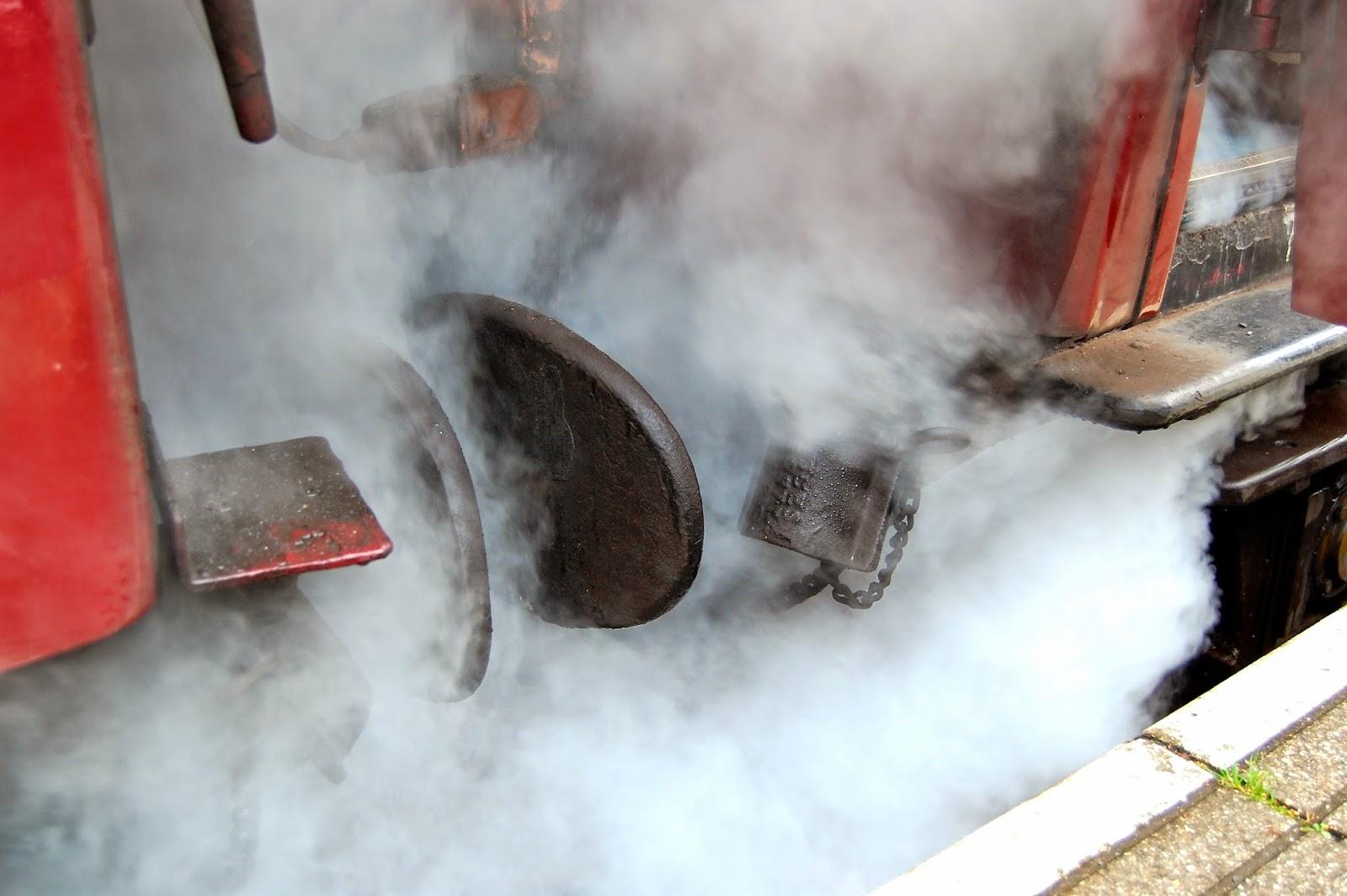 Steam between the train couplings
