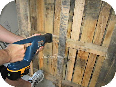 cutting the wood pallet for the wine holder