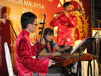 The 3 piece Traditional Chinese Band performing live at Nikon's appreciation and CNY dinner event