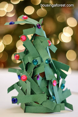 http://www.housingaforest.com/paper-strip-christmas-tree/