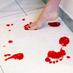 bloody footprint bath mat