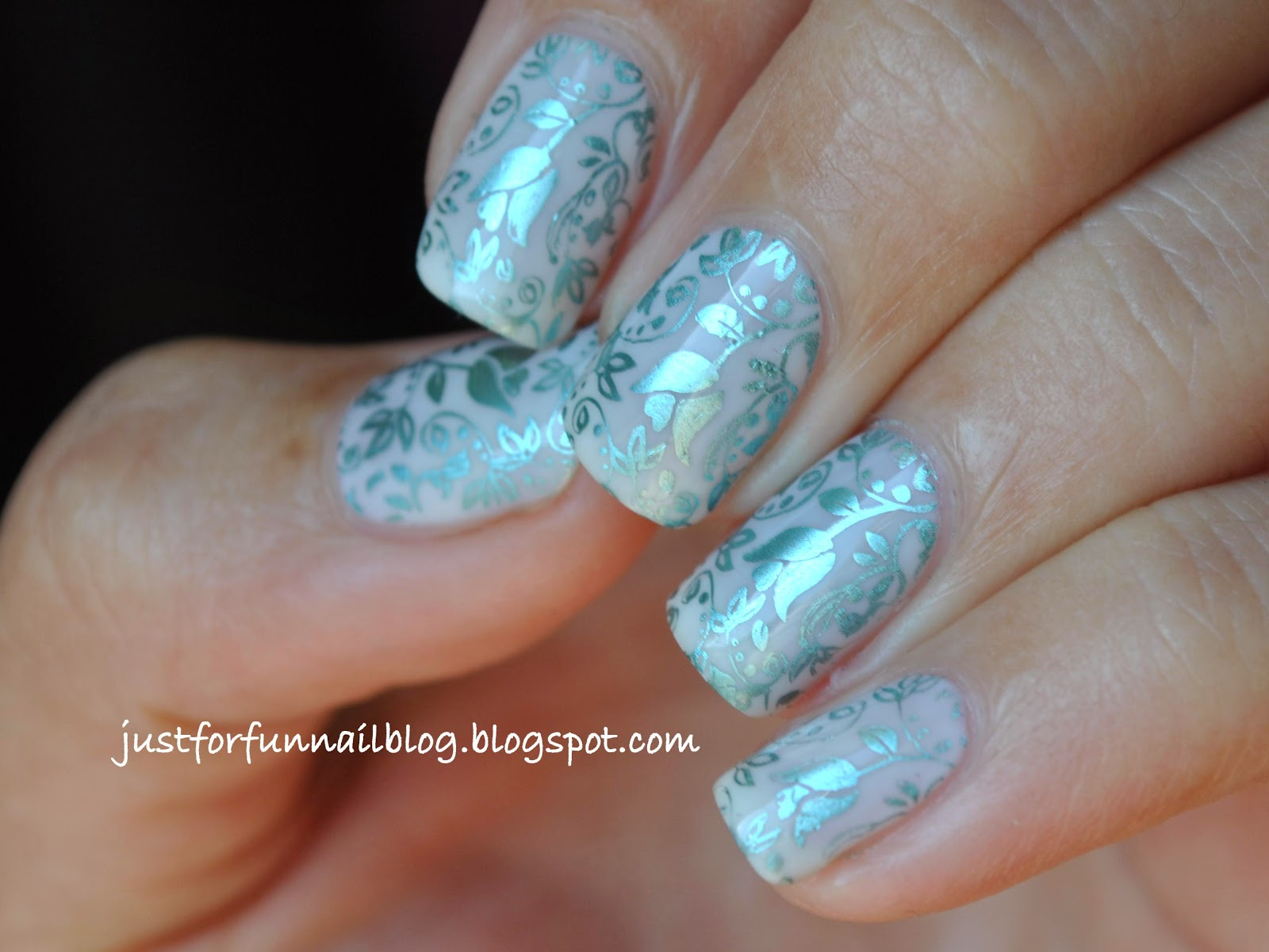 Turquoise flower stamping over white delicate base