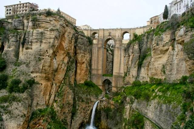 This huge bridge connects the two parts of the city of Ronda, and took 42 years to build, beginning in 1751. The chamber over the central arch was used for a variety of nefarious purposes, including as a prison and a torture chamber.