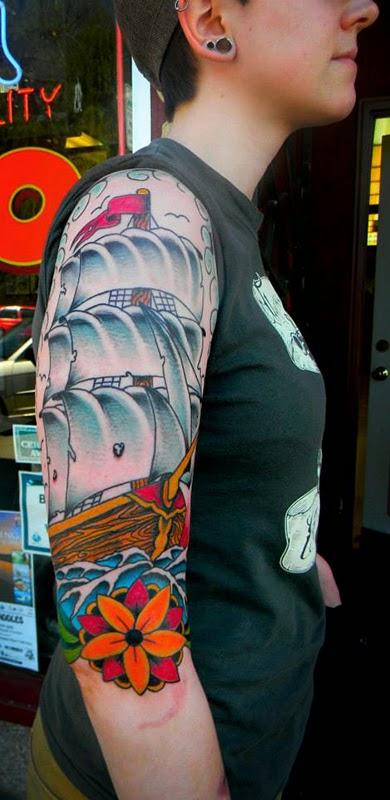 Half sleeve tattoo of a ship on rolling waves by Tattoo artist Mark Stewart for Triumph Tattoo