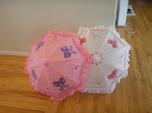 pink and white polka dot parasols