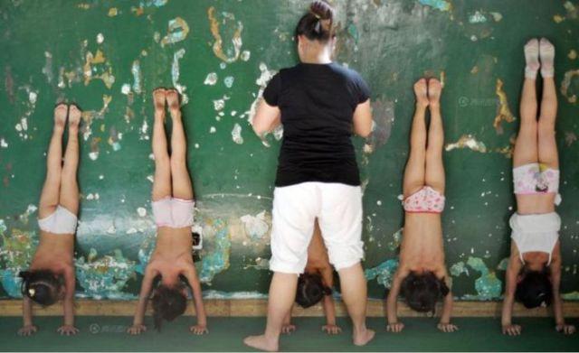 الصين وكيفية صناعة الأبطال الألومبيين China-gymnasium-Olympic-children-24