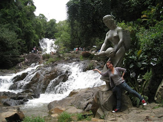 Hadas spreading water on the Waterfall Datanla