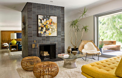 cool black center fireplace with fun twists of an owl and vibrant abstract painting