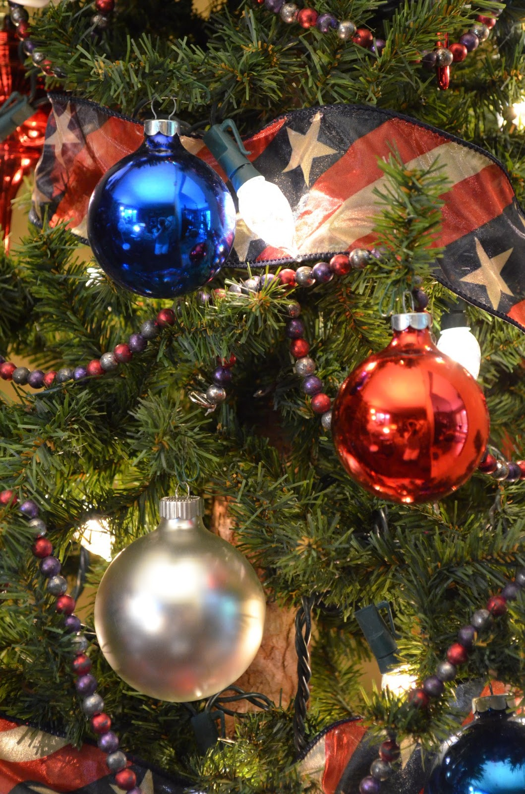 Red white and blue christmas ornaments - Also Make Sure That You Keep The Larger Ornaments Like These Fancy Red Ones Closer To The Bottom Of The Tree Or Else It Will Have A Weird Shape To It When