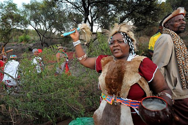 Traditional Healer Performs A Cleansing And Thanksgiving Ceremony In