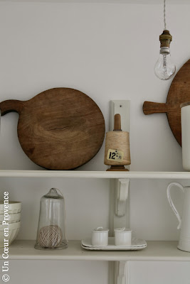 Old wooden chopping board and 'Seletti' crockery